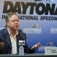 Photo - CORRECTS TO BRIAN-Brian France, CEO and Chairman of NASCAR answers questions during a news conference the prior to the Sprint cup Series auto race at Daytona International Speedway in Daytona Beach, Fla., Saturday, July 5, 2014. (AP Photo/John Raoux)