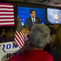 Photo -   Supporters of Republican vice presidential nominee Rep. Paul Ryan, of Wisconsin, gather at the Holiday Inn Express in Janesville, Wis. to watch his debate with Vice President Joe Biden on Thursday, Oct. 11, 2012. (AP Photo/The Janesville Gazette, Mark Kauzlarich)