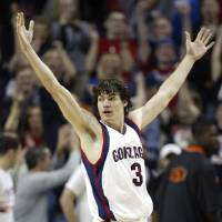 Photo - COLLEGE BASKETBALL: Gonzaga's Adam Morrison throws his arms up at the end of the game after scoring the winning shot in the closing seconds of their 64-62 win over Oklahoma State University (OSU) in Seattle Saturday, Dec. 10,  2005. (AP Photo/John Froschauer)