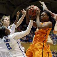 Photo - Duke's Alexis Jones (2), Allison Vernerey and Haley Peters, right, guard Oklahoma State's Toni Young during the first half of a second-round game in the women's NCAA college basketball tournament in Durham, N.C., Tuesday, March 26, 2013. (AP Photo/Gerry Broome) ORG XMIT: NCGB101