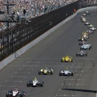 Photo - The field, lead by Will Power, of Australia, snakes down the main straightaway during the 98th running of the Indianapolis 500 IndyCar auto race at the Indianapolis Motor Speedway in Indianapolis, Sunday, May 25, 2014. (AP Photo/Darron Cummings)