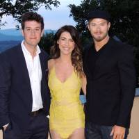 Photo - In this photo taken on Tuesday, May 20, 2014, from left, television personality Ben Lyons, actress Jacqueline MacInnes Wood and actor Kellan Lutz pose prior to a dinner at the Terre Blanche Hotel Spa Golf Resort in Tourrettes, France. Guests were invited to the property as a break from the Cannes Film Festival which is taking place in nearby Cannes. (AP Photo/Nekesa Moody)