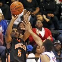 Photo -  Douglass junior Stephen Clark and the two-time defending champion Trojans will be in action at the All-City Preview tournament, which begins on Tuesday night.