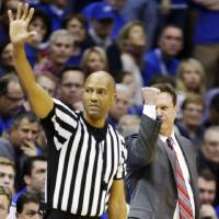 Photo - Kansas head coach Bill Self signals for a call from an official at the other end of the court while standing behind referee Bert Smith during the second half of an NCAA college basketball game against Oklahoma in Lawrence, Kan., Saturday, Jan. 26, 2013. Kansas won 67-54. (AP Photo/Orlin Wagner) ORG XMIT: KSOW110
