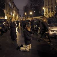 Photo - An opponent of gay marriage prays during a demonstration in Paris, Tuesday, Jan. 29, 2013.  The French government has presented a plan for debate in Parliament to legalize gay marriage and adoption. (AP Photo/Christophe Ena)