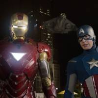 Photo -   In this film image released by Disney, Iron Man, portrayed by Robert Downey Jr., left, and Captain America, portrayed by Chris Evans, are shown in a scene from