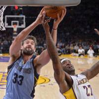 Photo - Memphis Grizzlies center Marc Gasol, left, of Spain, and Los Angeles Lakers forward Jordan Hill battle for a rebound during the first half of an NBA basketball game, Sunday, April 13, 2014, in Los Angeles.  (AP Photo/Mark J. Terrill)