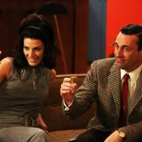 Photo - This publicity photo provided by AMC shows Jessica Pare as Megan Draper, left, and Jon Hamm as Don Draper in a scene of