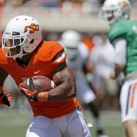 Photo - OKLAHOMA STATE UNIVERSITY / COLLEGE FOOTBALL: Oklahoma State's Jeremy Smith runs during OSU's spring football game at Boone Pickens Stadium in Stillwater, Okla., Sat., April 20, 2013. Photo by Bryan Terry, The Oklahoman
