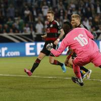 Photo - Germany's Andre Schuerrle, second from right, scores during a friendly WCup preparation soccer match between Germany and Cameroon in Moenchengladbach, Germany, Monday, June 2, 2014. (AP Photo/Frank Augstein)