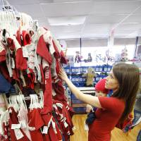 Photo - Kristen Zakariassen shops for baby clothes with her 5-month-old son, Dechlan, at Once Upon A Child in Oklahoma City.  Steve Gooch - The Oklahoman