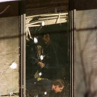 Photo - Orange cones mark evidence outside as ATF agents inspect inside areas near blast-damaged windows of an abortion clinic Monday Jan. 20, 1996, in Tulsa, Okla. Two explosions rocked the clinic Sunday, Jan. 19, 1997, for the second time this month. (AP Photo/Michael Wyke)