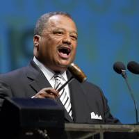 Photo - Fred Luter, Jr. , President of the Southern Baptist Convention, and senior pastor of the Franklin Ave Baptist Church in New Orleans speaks to members Wednesday, June 12, 2013, in Houston. The Southern Baptist Convention approved a resolution Wednesday expressing its opposition to the Boy Scouts of America's new policy allowing gay Scouts, though it doesn't explicitly call for churches to drop all ties with the organization.(AP Photo/Bob Levey)