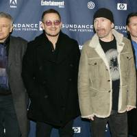 Photo - In this Jan. 19, 2008 file photo, U2 band members, from left, Adam Clayton, Bono, The Edge, and Larry Mullen Jr. arrive at the premiere of their film