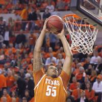 Photo - Texas center Cameron Ridley dunks during the first half of an NCAA college basketball game against Oklahoma State in Stillwater, Okla., Saturday, March 2, 2013. (AP Photo/Brody Schmidt)