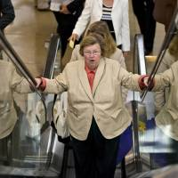 Photo - Senate Appropriations Committee Chair Sen. Barbara Mikulski, D-Md. rides an escalator on Capitol in Washington, Wednesday, July 10, 2013, as senators rushed to the floor for a vote to end debate on the Democrats' plan to restore lower interest rates on student loans one week after Congress' inaction caused those rates to double. The White House and most Senate Democrats favored restoring interest rates on subsidized Stafford loans to 3.4 percent for another year, but lawmakers failed to muster the necessary 60 votes to overcome a procedural hurdle.  (AP Photo/J. Scott Applewhite)