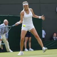Photo - Victoria Azarenka of Belarus returns against Mirjana Lucic-Baroni of Croatia during their first round match at the All England Lawn Tennis Championships in Wimbledon, London, Monday, June 23, 2014. (AP Photo/Ben Curtis)