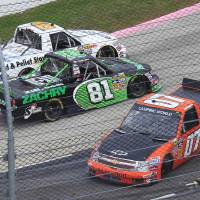 Photo -   Jeff Agnew (07) spins out as David Starr (81) and Max Gresham (8) pass by in turn two during the NASCAR truck race at Martinsville Speedway in Martinsville, VA., Saturday, Oct. 27, 2012. (AP Photo/Steve Helber)
