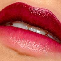 Photo - Here, ombre lipstick techniques are used to transition a deep red upper lip into an almost nude shade on the bottom lip. Photo provided.