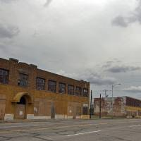 Photo - The Film Exchange Building may soon be torn down unless preservationists succeed in convincing the city to incorporate the building as part of the new Core to Shore park. The building is one of the last remnants of the neighborhood that once stood south of downtown.  SARAH PHIPPS