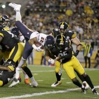 Photo - Chicago Bears running back Matt Forte (22) goes in for a touchdown over Pittsburgh Steelers free safety Ryan Clark (25) in the first quarter of an NFL football game in Pittsburgh, Sunday, Sept. 22, 2013. (AP Photo/Gene J. Puskar)
