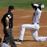 Photo -   Chicago White Sox's Alexei Ramirez reacts to being called out at stealing second base by umpire Mike Estabrook during the third inning of a baseball game against the Cleveland Indians, Tuesday, Sept. 25, 2012, in Chicago. (AP Photo/John Smierciak)