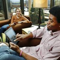 Photo - Oklahoma Christian University sophomore Vivian Edmunson and junior Zekariah McNeal are shown on the OC campus reading the university's new