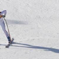 Photo - United States' Laurenne Ross pauses after finishing the women's super-G at the Sochi 2014 Winter Olympics, Saturday, Feb. 15, 2014, in Krasnaya Polyana, Russia. (AP Photo/Christophe Ena)
