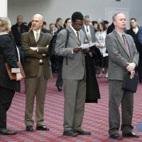 Photo -   FILE - In this March 7, 2012, file photo shows job seekers standing line during the Career Expo job fair, in Portland, Ore. Employers pulled back sharply on hiring last month, a reminder that the U.S. economy may not be growing fast enough to sustain robust job growth. The unemployment rate dipped, but mostly because more Americans stopped looking for work. The Labor Department says the economy added 120,000 jobs in March, down from more than 200,000 in each of the previous three months. (AP Photo/Rick Bowmer)