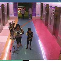 Photo - In this hospital surveillance photo released by the Phoenix Police Department on Monday, Dec. 3, 2012, a woman is seen with her 11-year-old daughter, a leukemia patient who had her arm amputated and a heart catheter inserted due to an infection. Authorities say the woman inexplicably took the girl from the hospital last week. Police say that if the catheter is left in too long it could lead to a deadly infection. The family's identity is being withheld but they are calling the girl Emily. (AP Photo/Phoenix Police Department)