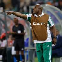 Photo - FILE - In this Feb. 10, 2013, file photo, Nigeria's head coach Stephen Keshi gestures during their African Cup of Nations final with Burkina Faso at the Soccer City Stadium in Johannesburg, South Africa. After impressing on their way to the second round in each of their first two FIFA World Cup appearances, 1994 and 1998, Nigeria have struggled since: going out at the group stage three times while taking just two points from their last eight matches in the finals. (AP Photo/Armando Franca, File)