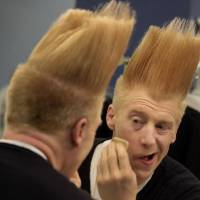 Photo - This March 23, 2013 photo shows performer Bello Nock appling make-up in his dressing room as he prepares for his