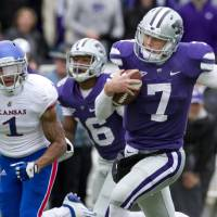 Photo -   Kansas State quarterback Collin Klein (7) runs for a touchdown past Kansas safety Lubbock Smith (1) during the second half of an NCAA college football game in Manhattan, Kan., Saturday, Oct. 6, 2012. (AP Photo/Orlin Wagner)