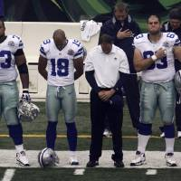 Photo - Dallas Cowboys players hang their heads prior to an NFL football game against the Cincinnati Bengals, Sunday, Dec. 9, 2012, in Cincinnati, during a moment of silence honoring teammate Jerry Brown who was killed in an automobile accident.  (AP Photo/Tom Uhlman)