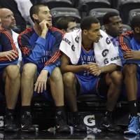 Photo - Oklahoma City Thunder players from left, Nenad Krstic, of Serbia, Nick Collison, Thabo Sefolosha, of Switzerland and Kevin Durant watch the final minutes of an NBA basketball game against the Orlando Magic from the bench in Orlando, Fla., Wednesday, Nov. 18, 2009. Orlando won 108-94. (AP Photo/John Raoux) ORG XMIT: DOA110