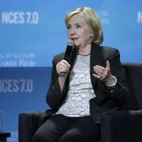 Photo - Former Secretary of State Hillary Rodham Clinton speaks at the National Clean Energy Summit Thursday, Sept. 4, 2014, in Las Vegas. (AP Photo/John Locher)