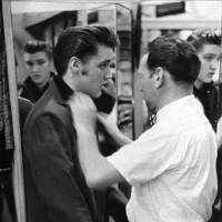 Photo -   FILE - This 1956 file photo originally released courtesy of Bernard Lansky shows singer Elvis Presley, left, being outfitted by clothier Bernard Lansky at Lansky's Men's Store in Memphis, Tenn. Lansky, who helped a young Elvis Presley establish his signature clothing style, died Thursday, Nov. 15, 2012 at his Memphis home, according to his granddaughter Julie Lansky. He started his retail business in Memphis in 1946 with a $125 loan from his father, Samuel. He was 85. (AP Photo/courtesy of Bernard Lansky, File)