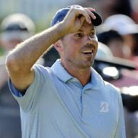 Photo -   Matt Kuchar lifts his hat after making par on the 15th hole during the second round of the Players Championship golf tournament at TPC Sawgrass, Friday, May 11, 2012, in Ponte Vedra Beach, Fla. (AP Photo/Chris O'Meara)