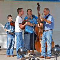 Photo -  The Second Time Around bluegrass band is a family affair with, from left, Lane Gore, 12, Cole Gore, 14, and their parents, Kathy and Gary Gore. They are from Stephenville, Texas. Photo by M. Tim Blake, for The Oklahoman   M. Tim Blake