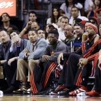 Photo - From left, Chicago Bulls' Kirk Hinrich, Derrick Rose, Nate Robinson, Richard Hamilton and Jimmy Butler watch from the bench during the final seconds of Game 2 of their NBA basketball playoff series in the Eastern Conference semifinals against the Miami Heat, Wednesday, May 8, 2013, in Miami. The Heat won 115-78. (AP Photo/Lynne Sladky)