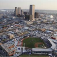 Photo - ONEOK Field stands in the foreground with the Tulsa skyline at rear. AP Photo
