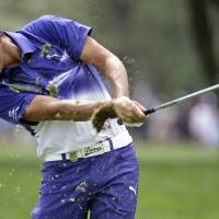 Photo - Rickie Fowler hits from the fairway on the first hole during the third round of the PGA Championship golf tournament at Valhalla Golf Club on Saturday, Aug. 9, 2014, in Louisville, Ky. (AP Photo/Jeff Roberson)