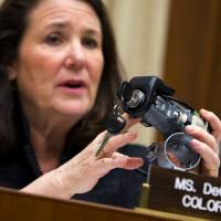 """Photo -  Rep. Diana DeGette, D-Colo., ranking member of the House Oversight and Investigations subcommittee, holds up a GM ignition switch while she questions General Motors CEO Mary Barra on Capitol Hill in Washington. Responding to complaints about """"cheap-feeling"""" switches that required too much effort to turn, General Motors set about making new ones that would work more smoothly and give drivers the impression that they were better designed, a GM switch engineer testified in a lawsuit deposition in the spring of 2013. The switches, though, were too loose, touching off events that led to at least 13 deaths, more than 50 crashes and a raft of legal trouble for the Detroit automaker. AP Photo   Evan Vucci -"""