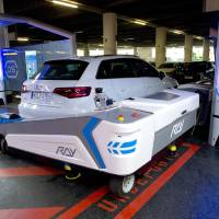 Photo -  Parking robot Ray moves a car Monday. The parking robot starts work Tuesday at Duesseldorf airport. AP Photo   Federico Gambarini -  AP