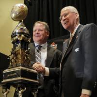 Photo - Oregon head coach Chip Kelly, left, and Kansas State head coach Bill Snyder pose for photographers with the Fiesta Bowl champions trophy Wednesday, Jan. 2, 2013, in Scottsdale,  Ariz. Oregon and Kansas state will face off Thursday in the Fiesta Bowl NCAA college football game. (AP Photo/Matt York)