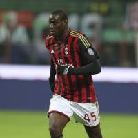 Photo - In this picture taken  Saturday, Nov. 23, 2013, AC Milan forward Mario Balotelli controls the ball during a Serie A soccer match between AC Milan and Genoa, at the San Siro stadium in Milan, Italy. Liverpool could be about to replace one controversial striker with another.  Italy international Mario Balotelli has been lined up by the Premier League club as a potential replacement for Luis Suarez, who left Anfield to join Barcelona for $130 million. Balotelli, who spent 2½ years with Manchester City up to 2013, left the club's Milanello training ground on Thursday, Aug. 21, 2014, for possibly the last time.