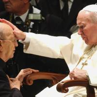 Photo - FILE - In this Nov. 30, 2004 file photo, Pope John Paul II gives his blessing to father Marcial Maciel, founder of the Legion of Christ, during a special audience at the Vatican. Pope Benedict XVI took over the Legion in 2010 after a Vatican investigation determined that Maciel had sexually molested seminarians and fathered three children by two women. Following a decision Thursday Feb. 14, 2013, by the Rhode Island Supreme Court, documents are set to be unsealed related to a lawsuit contesting the will of Gabrielle Mee, who left $60 million to the Legion. (AP Photo/Plinio Lepri, File)