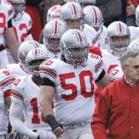 Photo - Ohio State head coach Jim Tressel motivates his players before entering the field before their college football game against Northwestern in Evanston, Ill. Saturday, Nov. 11, 2006. (AP Photo/Charles Rex Arbogast) ORG XMIT: OTKKS111