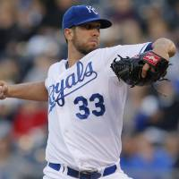 Photo - Kansas City Royals starting pitcher James Shields delivers to a Colorado Rockies batter during the first inning of a baseball game at Kauffman Stadium in Kansas City, Mo., Tuesday, May 13, 2014. (AP Photo/Orlin Wagner)