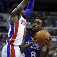 Photo - Philadelphia 76ers guard Tony Wroten (8) tries going to the basket against Detroit Pistons guard Will Bynum (12) during the first half of an NBA basketball game Saturday, Feb. 1, 2014, in Auburn Hills, Mich. (AP Photo/Duane Burleson)
